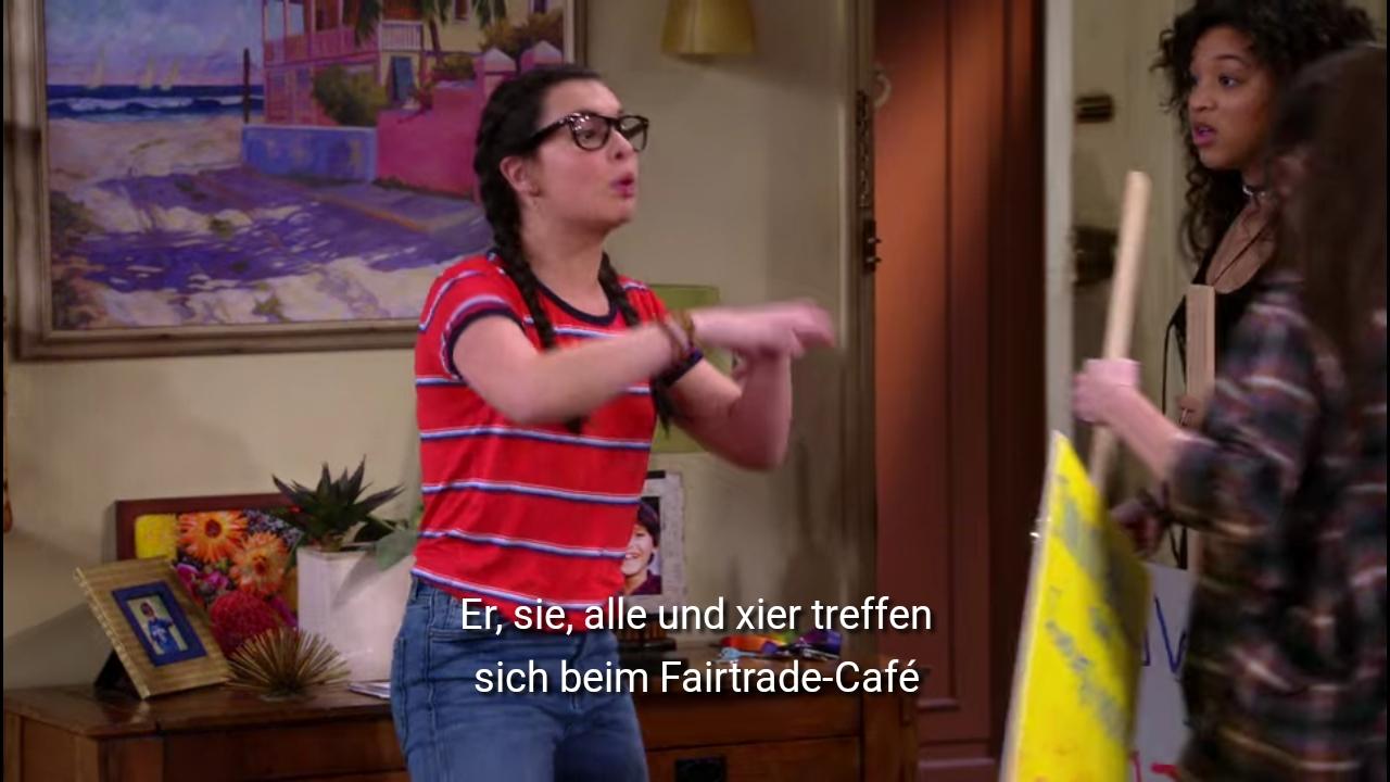 Elena sagt weiter: Er, sie, alle und xier treffen sich beim Fairtrade Café.